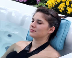 Brunette woman relaxing in spa with spa pillow